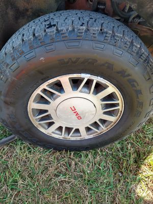 4 tires97 GMC Jimmy4x4 I wheels factory mag wheels with centers brand new Jeep Wrangler tires for Sale in Nashville, TN