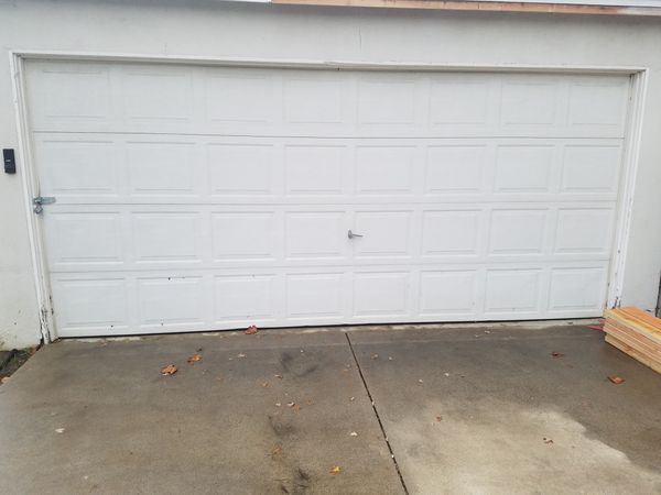 garage door white roll up with track and hardware. 188 inches long standard height.