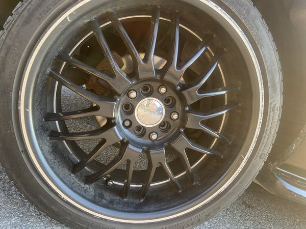 """Black 18"""" rims and tires"""
