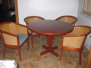 4 wood and cane back chairs with matching solid wood table for Sale in Chicago, IL
