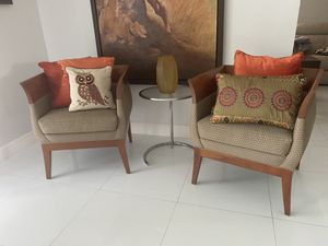 Designer wooden and fabric chairs. 2 of them. Sold separately or as a pair. for Sale in Miami, FL
