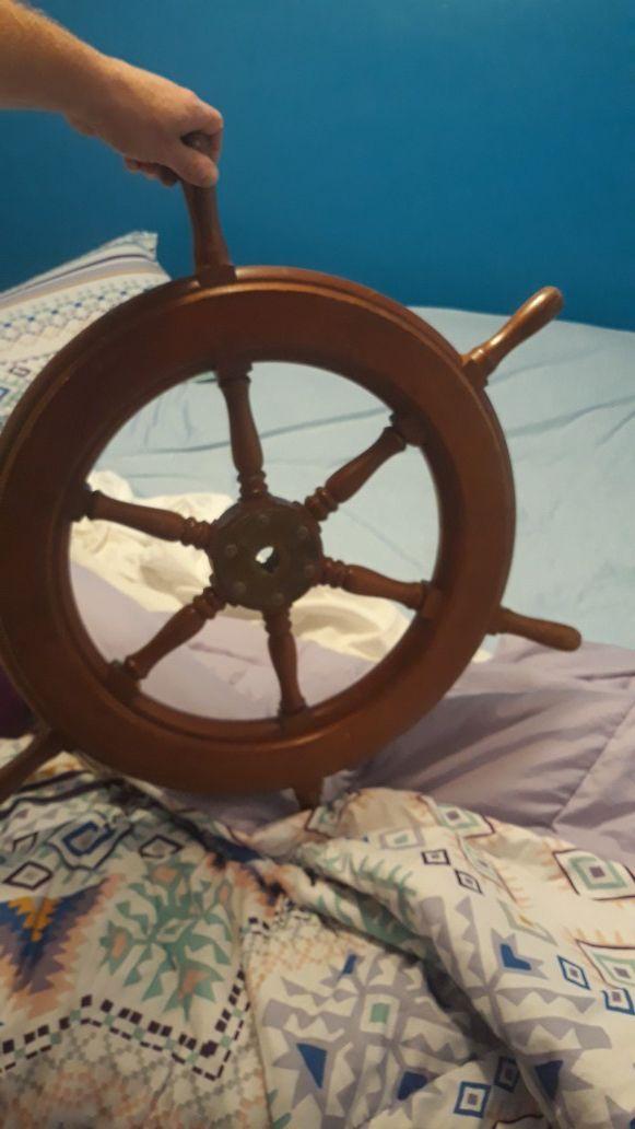 Ships wheel, antique brass prop, and Alaskan drift net floats decor
