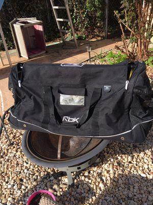 Like new Reebok duffle bag on wheels for Sale in Sanatoga, PA