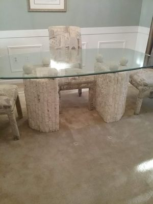 Table with stone pedestals and marble. Glass top and fabric covered chairs for Sale in Fort Washington, MD