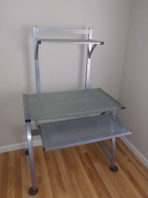 Computer desk with bookshelve. Glass and metal with slide out keyboard tray. for Sale in Visalia, CA