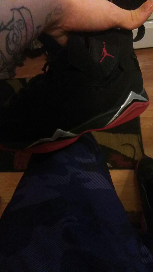Black and red Jordan's 9.5