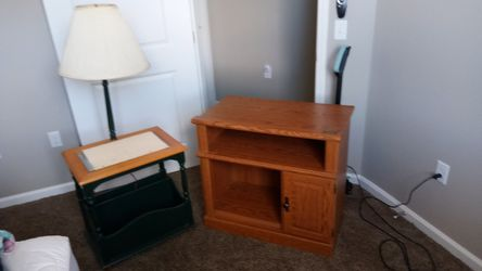 T.v. stand and coffee table with a lamp attached to it for Sale in Muscatine,  IA