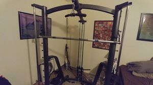 Squat rack Smith machine Lat Pull and low row pulleys included with rack. for Sale in Watauga, TX