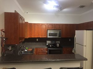 Kitchen cabinets with counter top and backsplash for Sale in Miami Gardens, FL
