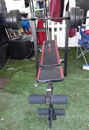 Cap weight bench with 100 lbs weights. New, never used. Easy to assem for Sale in Houston, TX