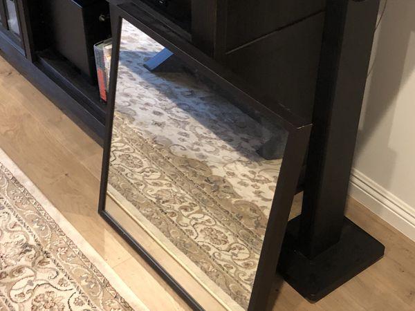 Wall mirror- brand new, dark wood frame, 24x24