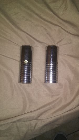 Very new chrome silver screw over pegs pair for bike 3/8 axle size. for Sale in North Las Vegas, NV