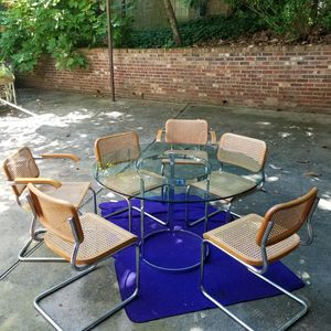 Glass table with chrome base with 6 chairs. for Sale in Atlanta, GA