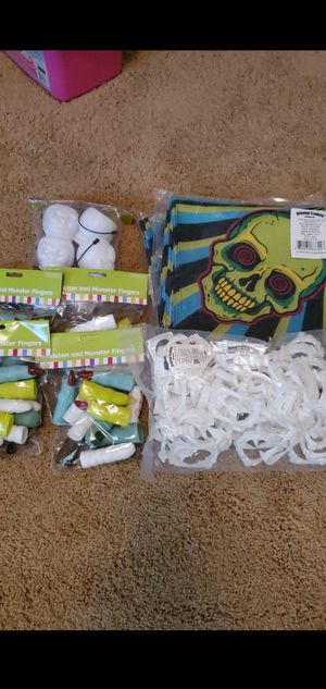 Halloween party supplies: spookadelic bandanas, skeleton monster fingers, vampire fangs, skeleton candy bowls for Sale in Maple Valley, WA