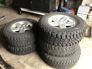 5 jeep tire and aluminum rims mud e snow one tire never used for Sale in Staten Island, NY