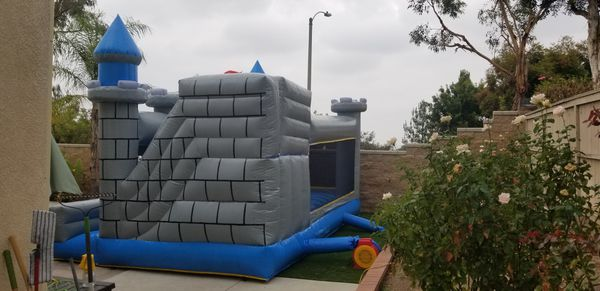 Commercial jumper with slide bounce house