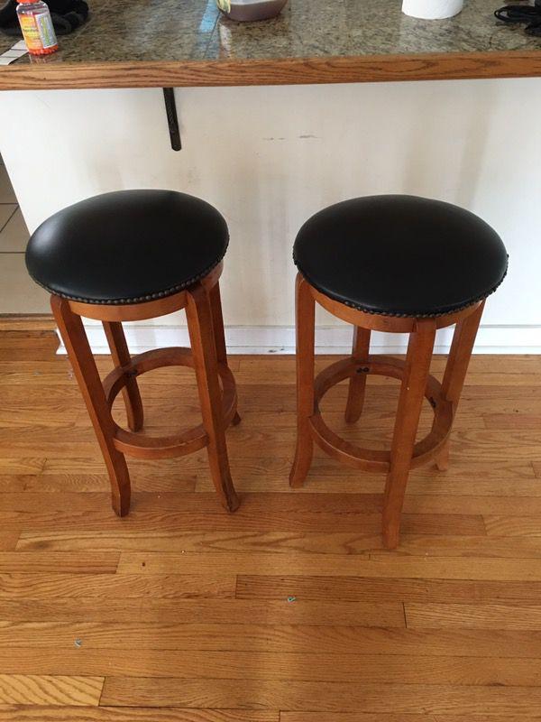 Wooden bar stools, black cushions