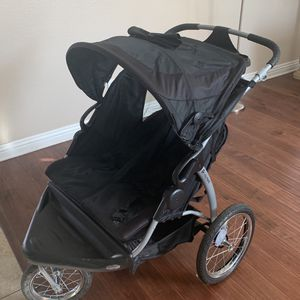 Black double Jogging stroller for Sale in Ontario, CA