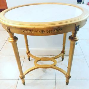 Antique french marble top with bronze accents coffe table for Sale in Miami, FL