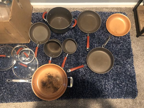 Rachel ray pan set with 2 copper pans and some Tupperware