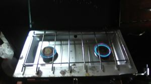 Coleman propane camping stove, 2 burners. Already equipped with half filled propane cylinder. for Sale in San Angelo, TX