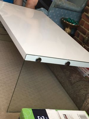 White coffee table with tempered glass legs for Sale in Alexandria, VA
