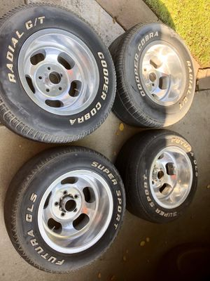 Old school slotted mag wheels. Tires are no good sizes 2 15x11. Good condition. A little curb rash on two wheels. for Sale in Fresno, CA