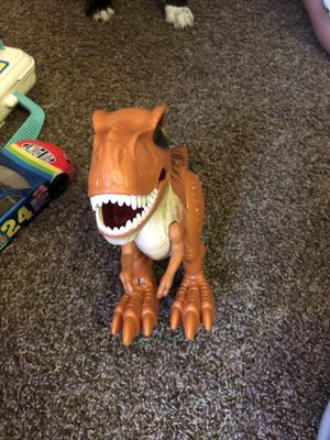 Dinosaur that walks ,practically brand new . for Sale in Bettendorf, IA