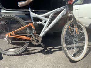 Avigo bike has 2 different tires but frame is good and runs very well has a cruiser seat for Sale in Tolleson, AZ