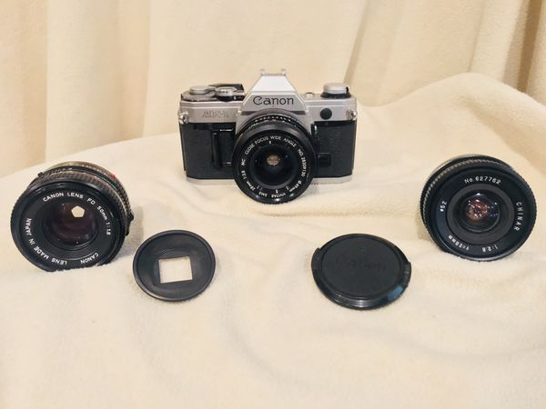 1 DAY SALE! Canon AE-1 w 3 lenses.