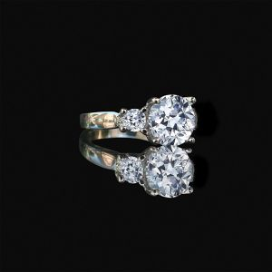 Three stone Sterling Silver ring with 3ct round center with double sides 0.25 ct. Stones ring, simulated diamond engagement ring for Sale in San Francisco, CA