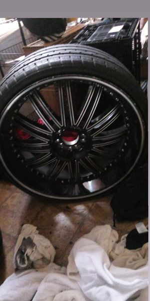 22 inch rims black and chrome with lexani tires ( need 1 tire) for Sale in Lawrenceville, VA