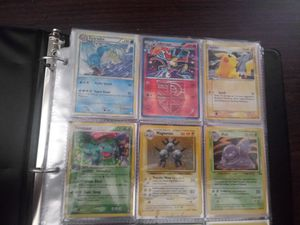 Selling pokemon binder with some vintage to new cards all rare for Sale in Kissimmee, FL