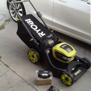 RYOBI 21 in. 40-Volt Brushless Lithium-Ion Cordless SMART TREK Self-Propelled Walk Behind Mower with 5.0Ah Battery and Charger for Sale in Huntington Beach, CA