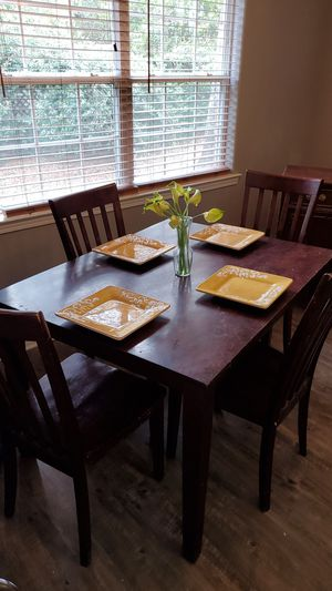 Dark wood dining room table with matching four chairs for Sale in Milton, FL