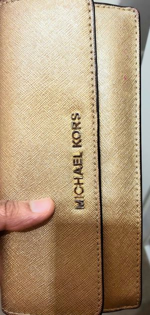 Michael Kors golden wallet- good used condition for Sale in Reston, VA