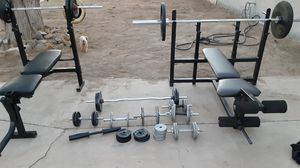 2 Olympic weight bench like brand new with weights and bars for Sale in Riverside, CA