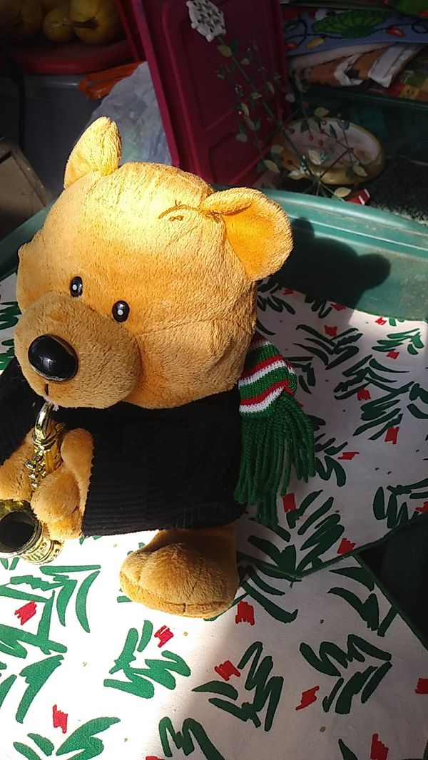 Christmas Bear playing saxophone