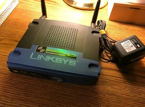 Linksys Wireless broadband router and a/c power cord only. Tested & working great! Model WRT54G v5 for Sale in Lake Forest, CA