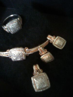 Diamond and Sterling Silver beautiful 4 piece set. Includes ring bracelet pendant and earrings for Sale in Vancouver, WA