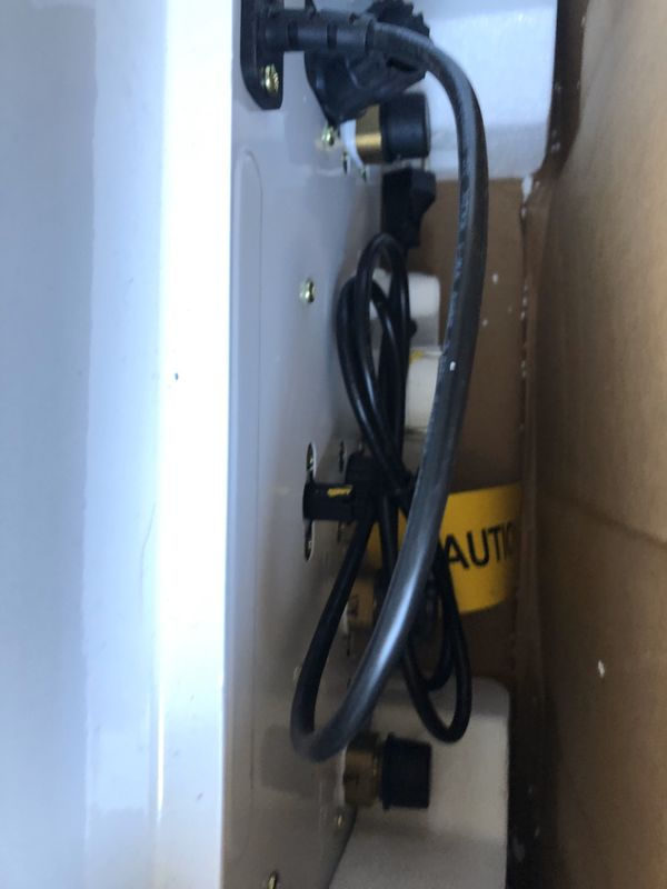 New in box. Tankless water heater Navien