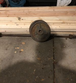 Olympic bar and set of 35 pound weights for Sale in Columbus, OH