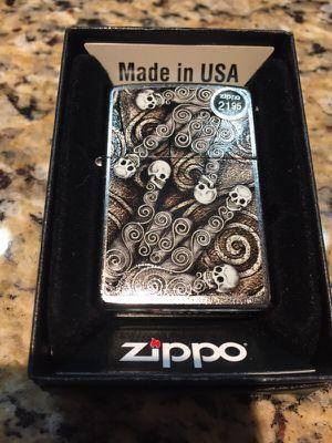 Skull scroll hand zippo lighter for Sale in Salt Lake City, UT