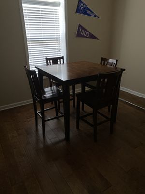 ***Gently Used Deep Wood High/Pub Table with 4 wooden chairs. In excellent condition. Has been cleaned with oil soak and polished with wood oil. for Sale in Atlanta, GA
