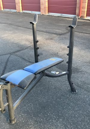 Marcy weight bench with bar and weights for Sale in Highlands Ranch, CO