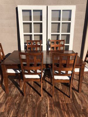 Heavy real wood dining room table and 8 identical chairs an additional extended leaf to make bigger for family dinners for Sale in Lodi, CA