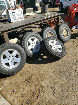 jeep rims and 4 1/2 to 5 1/2 5 lug wheel adapters for Sale in Phelan, CA