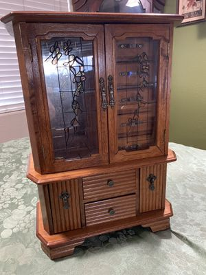 Solid wood Antique musical Jewelry Armoire in great condition with lots of space to keep your jewelry. Cash and pick up only. $40 for Sale in Riverside, CA