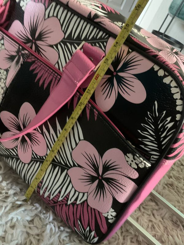 Vintage Roxy rolling duffel bag with toiletry case