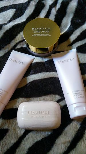 Two new 3.4 FL OZ Estee Lauder lotions, I soap, a perfumed body powder for Sale in Modesto, CA